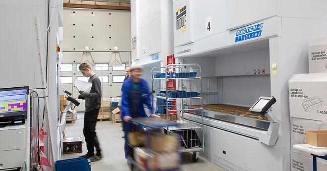4 Modula lagerautomater frigør 350 m2 lagerplads, som nu bruges til nye produktionslinjer. Kunde: Frontmatec. Leveret af Hans Schourup