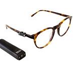 OrCam ved siden af brille.