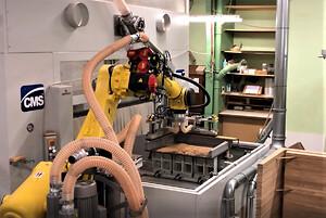 CMS cnc maskine og Fanuc robot i skræddersyet automationsløsning fra Gibotech