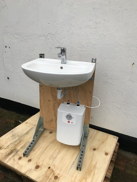 Mangler din butik en håndvask ved indgangen