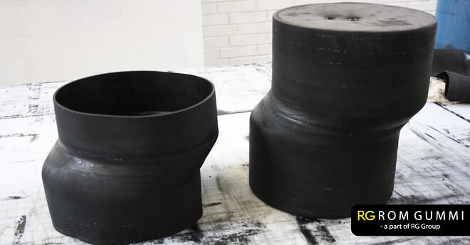 RG Gummimanchette som overgang mellem forskudte rør. Rom gummi A/S