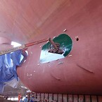 Scrubber hull outlet protection coating