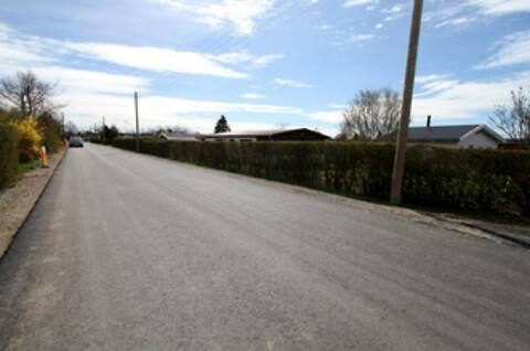 Skal grusvejen skiftes ud med asfalt - Skal grusvejen skiftes ud med asfalt