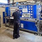 När reparationen är klar testas enheten för korrekt tryck och flöde, vilket dokumenteras med en detaljerad testrapport