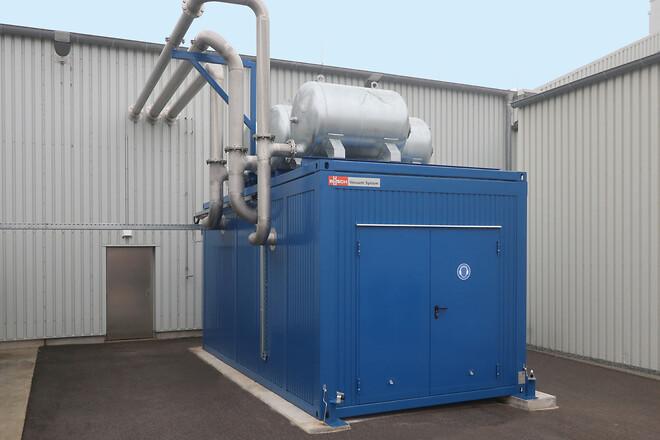 Centraliserad vakuumtillförsel installerad i en container av utrymmesskäl