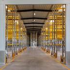 Det nye lager er indrettet med pallereoler i 6300 mm højde og med integreret scannersystem.