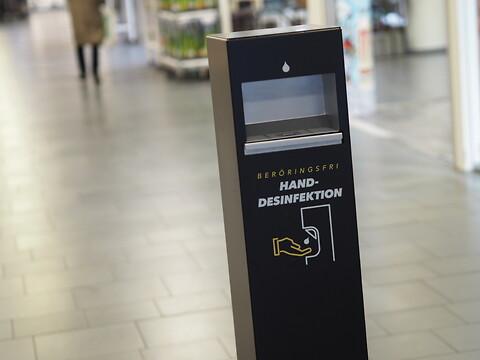 En stilren beröringsfri handdesinfektionsautomat - H-Check - Handdesinfektionsautomat