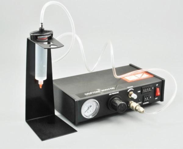 Pneumatisk interval dispenser til sprøjter